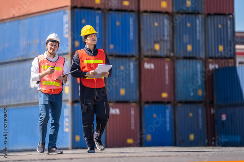 Logistics engineer control at the port, loading containers for trucks  export an Tablou Canvas