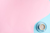 Creative pastel blue pink background with ceramic cup of freshly brewed coffee drink