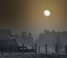 Full Moon And Concrete Poles O...