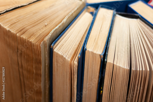 Valokuvatapetti Old and well used hardback books or text books in a book shop or library