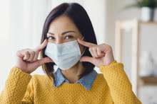 Portrait Of Young Asian Woman,  Wearing A Medical Surgical Disposable Face Mask To Prevent Infection, Virus, Air Pollution