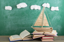Education Is A Journey Concept, Toy Boat And Books On The Chalkboard Background, Inspiration For A Fairy Tale