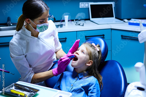 Young female dentist working in her office.