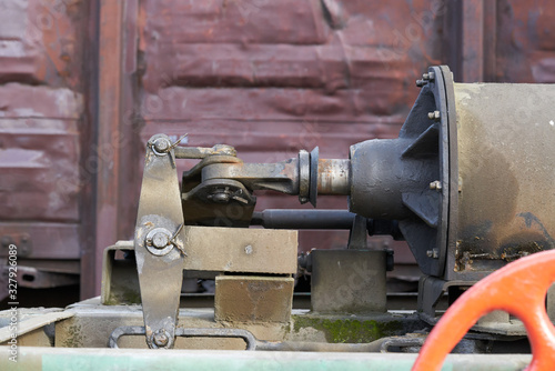 Photo industrial background - hydraulic actuator of locomotive brake close up