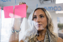 Creative Businesswoman Brainstorming, Writing On Adhesive Notes In Off