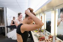 Female Ballerina Fixing Hair B...