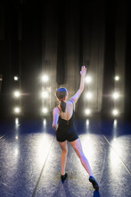 Young Female Jazz Dancer Rehearsing On Stage