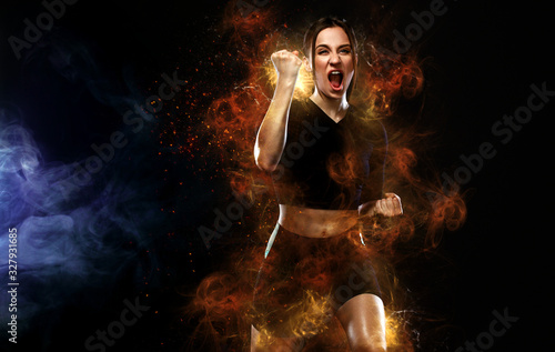 obraz PCV Sprinter and runner girl. Running concept. Fitness and sport motivation. Strong and fit athletic, woman sprinter or runner, running on black background in the fire wearing sportswear.