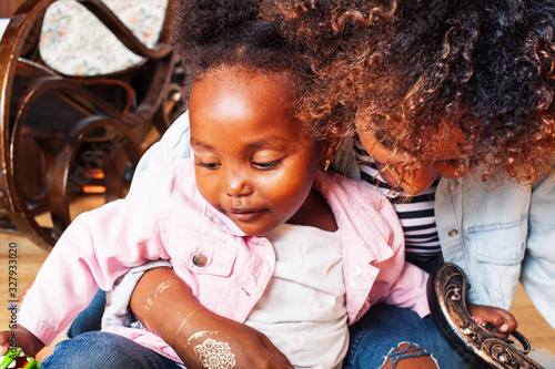 Obraz adorable sweet young afro-american mother with cute little daughter, hanging at home, having fun playing smiling, lifestyle people concept, queen girl - fototapety do salonu