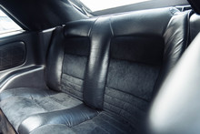 Rear Leather Seats Of A Coupe Convertible Car. Luxury Car Interior.
