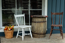 Barrel Table And Chairs On Porch Outside Store Window