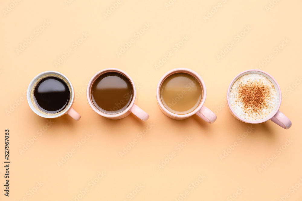 Fototapeta Cups of different coffee on color background