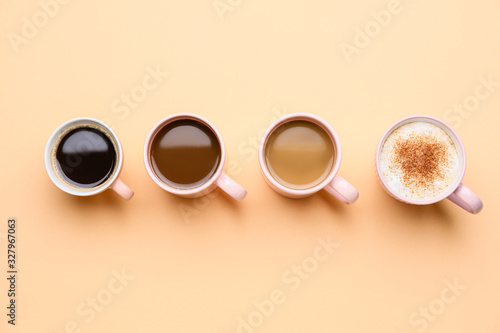 Fototapeta Cups of different coffee on color background obraz