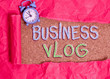 canvas print picture - Text sign showing Business Vlog. Business photo showcasing A video content about subject matter related to the company Alarm clock and torn cardboard placed above a wooden classic table backdrop