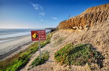 Sign Warns That The Cliffs Beh...