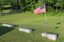 US Flag With Three Gravestones At A Cemetery In Vermont