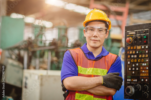Papel de parede Portrait of smart engineer Asian Chinese happy labor worker handsome model in heavy industry  background