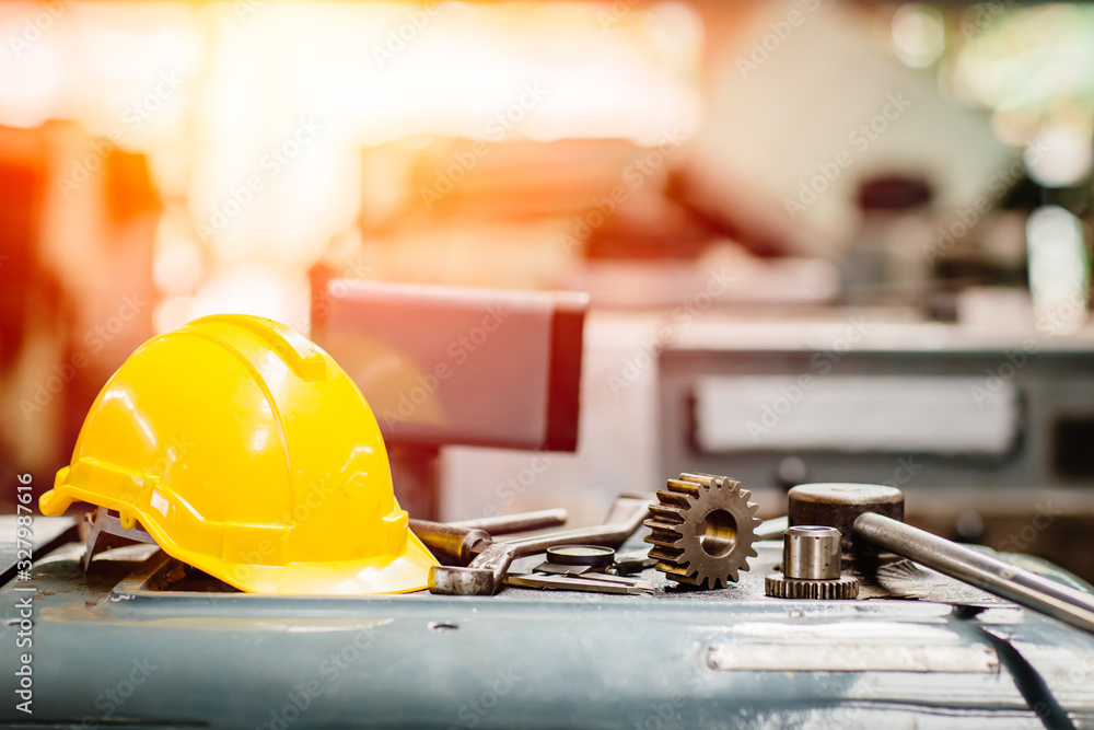 Fototapeta yellow helmet hardhat with instruments gear tools in factory for background.