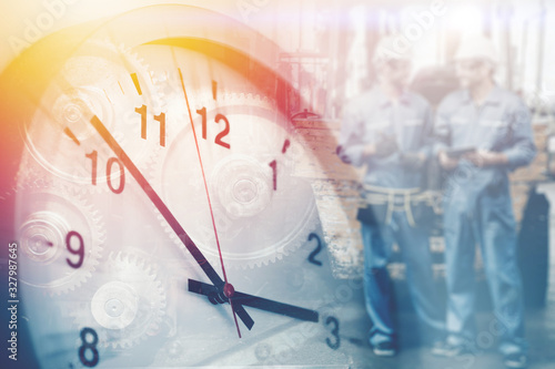 Obraz na plátně worker working times, working hours of labor indutry factory time concept