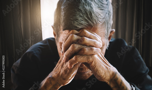 senior man covering his face with his hands Wallpaper Mural