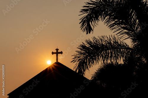 Sun coming up behind a church Wallpaper Mural