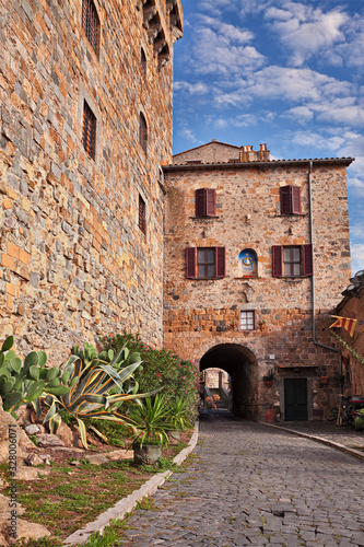 Bolsena, Viterbo, Lazio, Italy: ancient alley that skirts the castle and the ent Wallpaper Mural