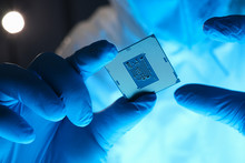 Hands In Gloves Hold Chip Testing Microelectronics. Setting Operating Modes Electronic Controllers. Use Chip Tuning To Increase Power. Repair Microprocessor Electronics Electrical Equipment