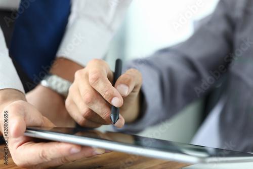 Valokuvatapetti Man holds stylus and puts signature on tablet