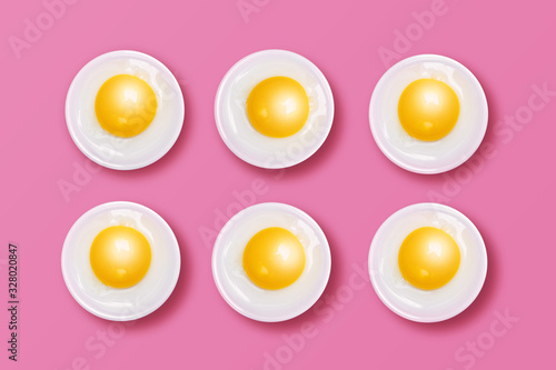 Photo Eggs - Yellow Yolks and White Albumens on Pink Background