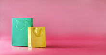 Color Gift Paper Bags On Bright Pink Background, Banner With Copy Space