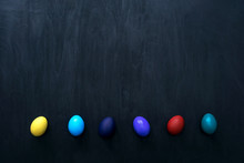 Color Easter Eggs In Sunbeam Over Black.