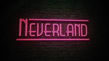 NEVERLAND Neon Red Sign On Dark Brick Wall