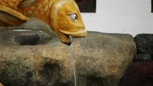 Asian Fountain With A Fish