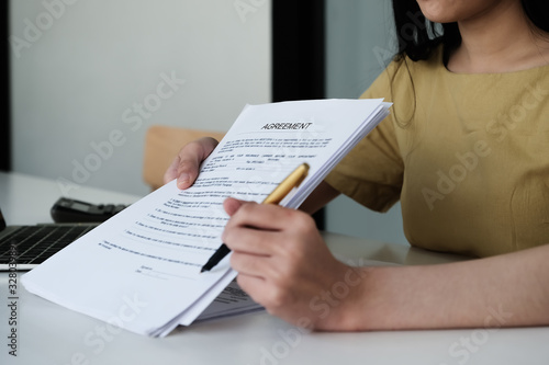Business woman and partner sign a contract investment professional document agreement in meeting room Wallpaper Mural