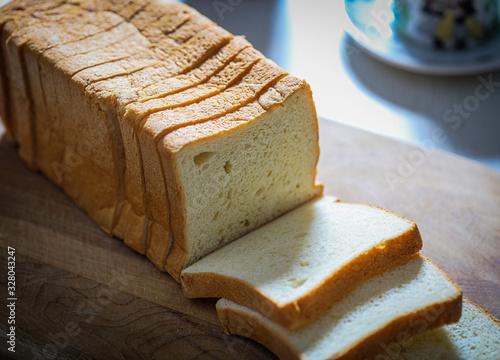 Stampa su Tela Sliced white bread over a table