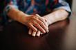 Hands of Real senior woman at home