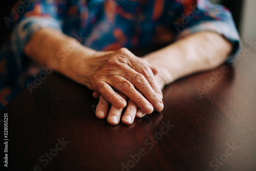 Hands of Real senior woman at home Fototapet