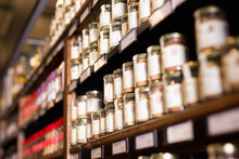 Spices In Glass Jars At Store
