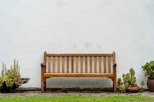 Wooden Bench Front Of A White ...