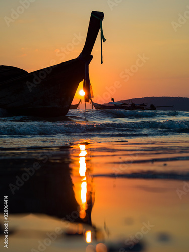 Traditional long-tail boat on the beach in Thailand Фотошпалери