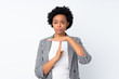 Leinwandbild Motiv African american woman with blazer over isolated white background making time out gesture