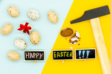 Happy Easter Creative Card. Pop Art Style. Blue And Yellow Background. Seven Eggs On One Side, One With Red Bow And One Smashed Chocolate Egg And Metal Hammer On Another Side. Close Up.