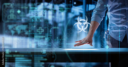 medical science doctor wotking with modern computer in biohazard sign UI at lab or hospital Canvas Print