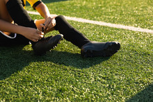 Close Up View Soccer Player Putting On His Shoes