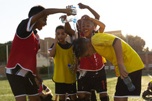 Soccer Players Putting Water O...