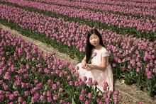 Girl Dreaming In Flower Field