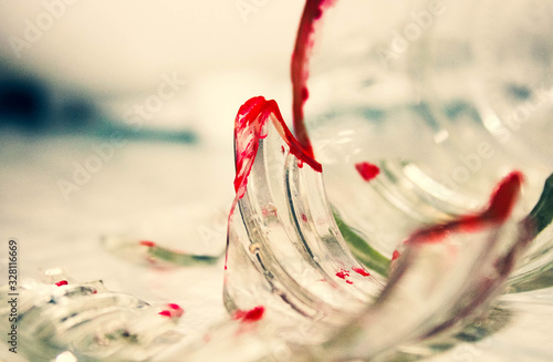 Bright broken shards with sharp edges smeared with blood. Canvas Print