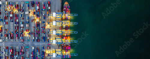 Fotografia, Obraz Container ship loading and unloading in deep sea port, Aerial view of business logistic import and export freight transportation by container ship in open sea, Container loading Cargo freight ship
