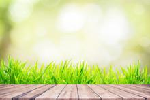 Fresh Green Grass With Bokeh Sunlight And Wooden Floor