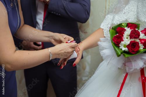 bride putting on jewelry, focus on bracelet Wallpaper Mural